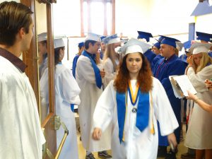Graduates leave the cafeteria before the ceremony