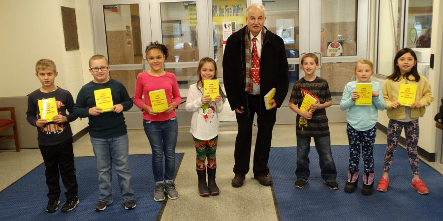 Student helpers pose with David Newkirk at school entrance