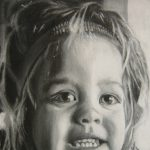 Black and white charcoal drawing of a young girl.