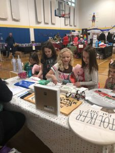 Checking out craft fair items