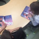 Students check out books purchased with the granat