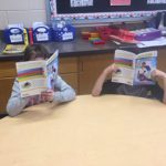 Student delving into reading two books