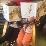 Students sitting closely and reading books