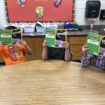 Three students reading books