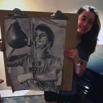 Student displaying her drawing of Rocky Balboa