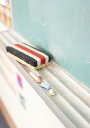 Graphic of an eraser on a chalkboard