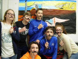 Several students with Dali mustaches