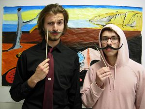 Students acting silly with Dali mustaches
