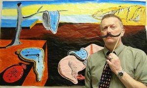Teacher posing with Salvador Dali painting