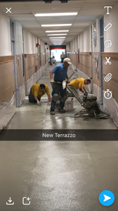 New terrazzo being installed at the elementary school entrance