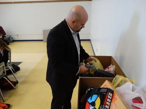 Assistant principal looking over gifts