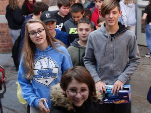 Several students carry gifts