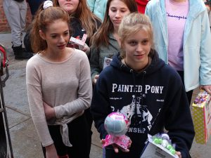 Two students bring gifts