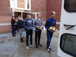 Students in line with gifts