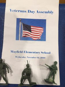 Sign introducing the veterans day program