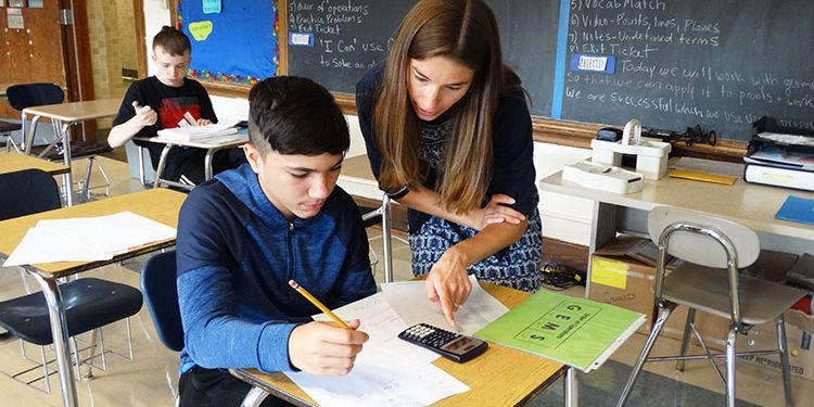 Math teacher helps a student