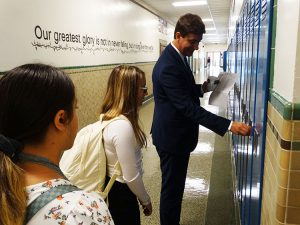 Principal Wojeski helping a student with a locker