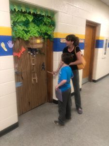 Parent and student studying a door
