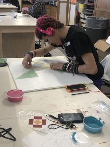 Student puts finishing touches on project