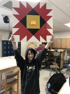 Student holds up project to show everybody