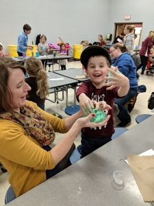 Student and parents check out the slime creation